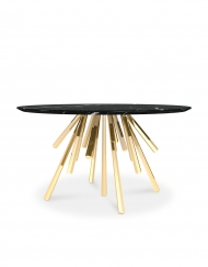 Amber is a contemporary dining table made of polished brass and marble by Bitangra Furniture Design